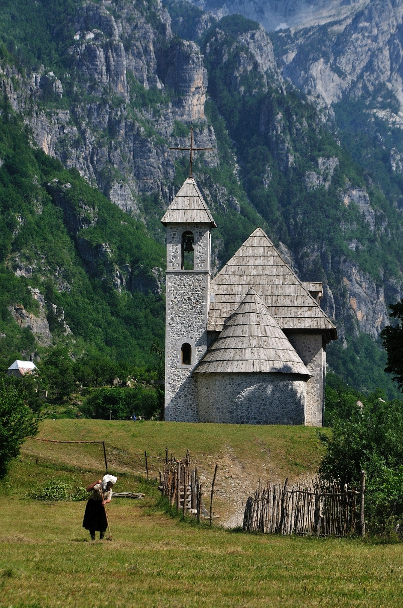 Albania cycling trip - Theth church with woman