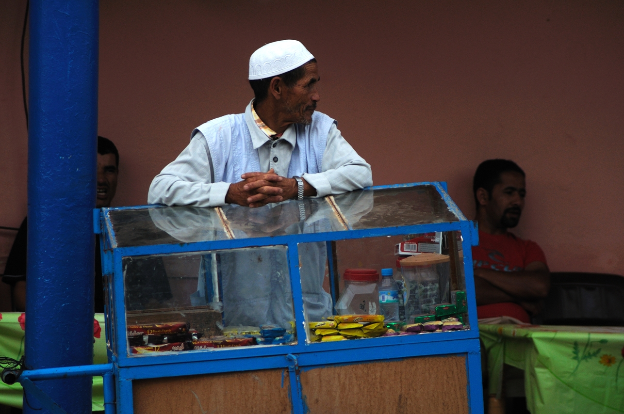 Man selling snacks in the street (not cactus figs)