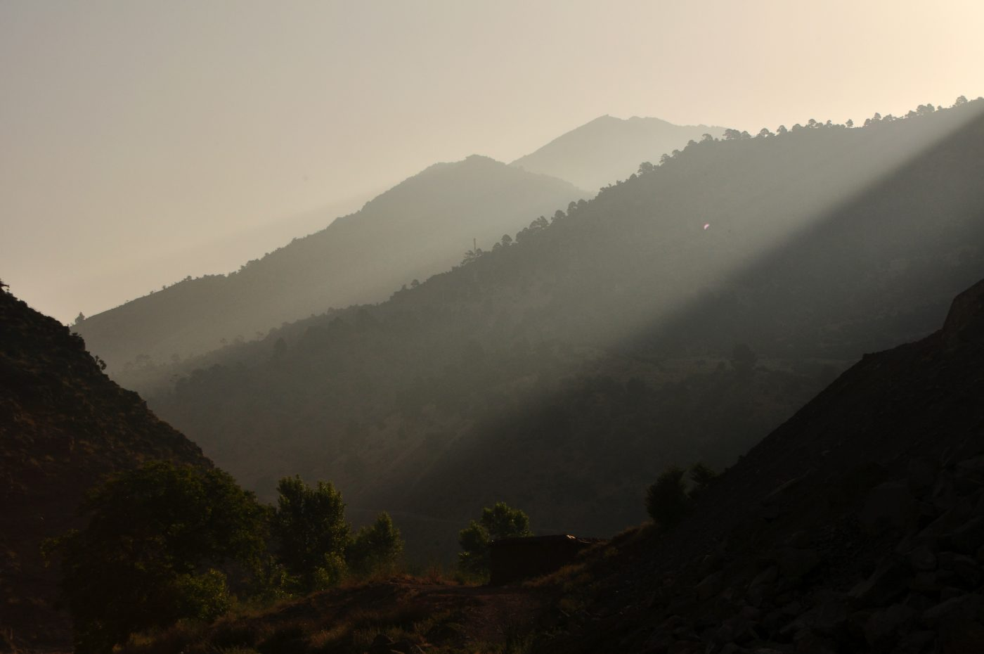 The sun rises over the mountain