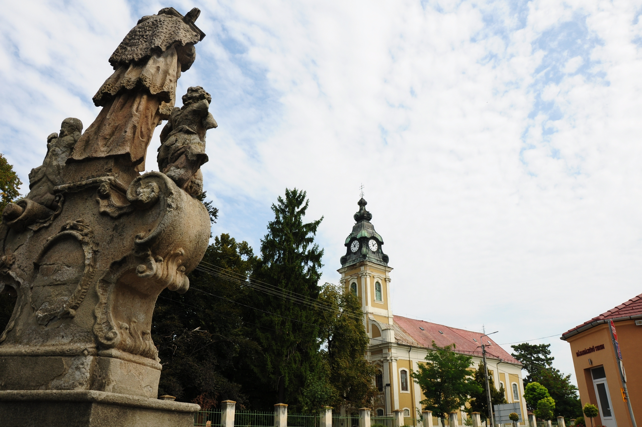All Baroque: statue and church in laid-back Sajópetri