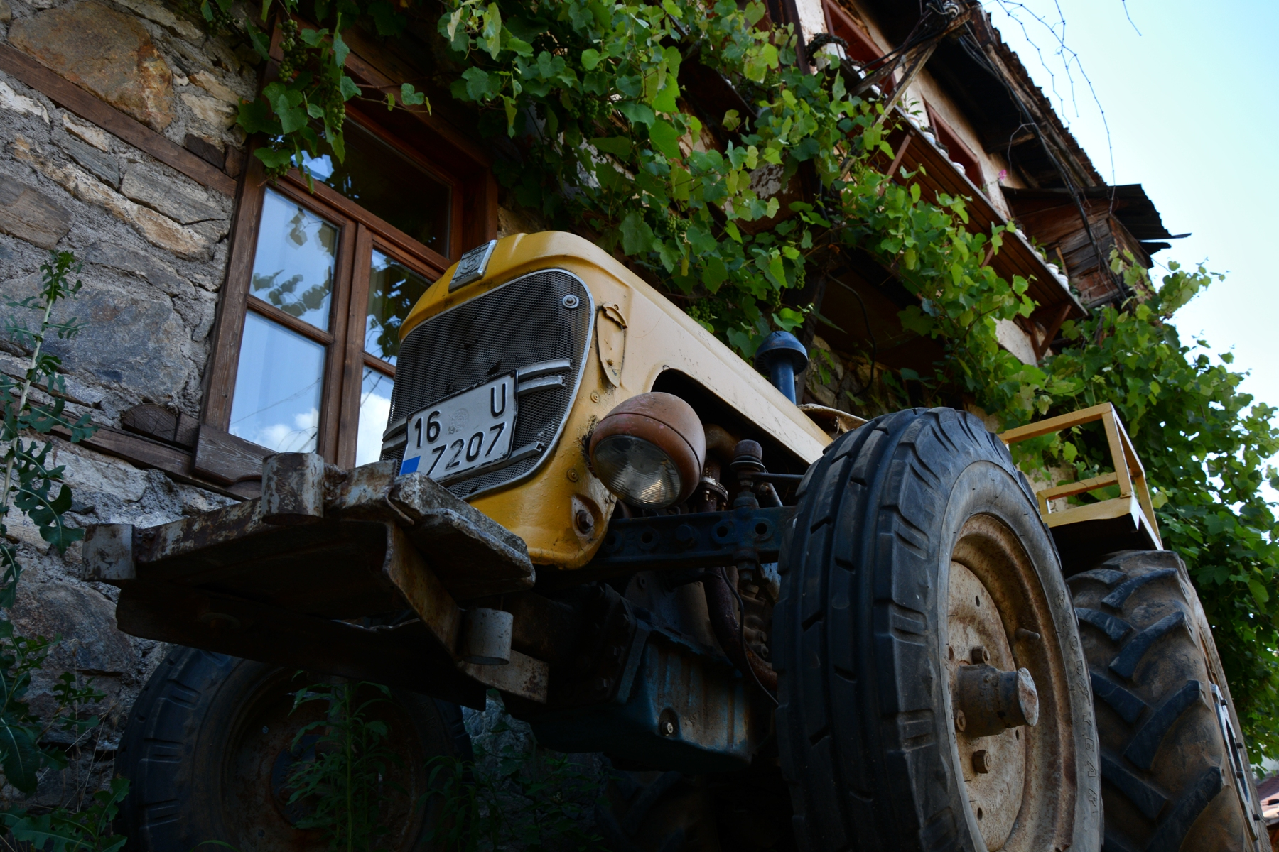 Tractor outside a house in the village