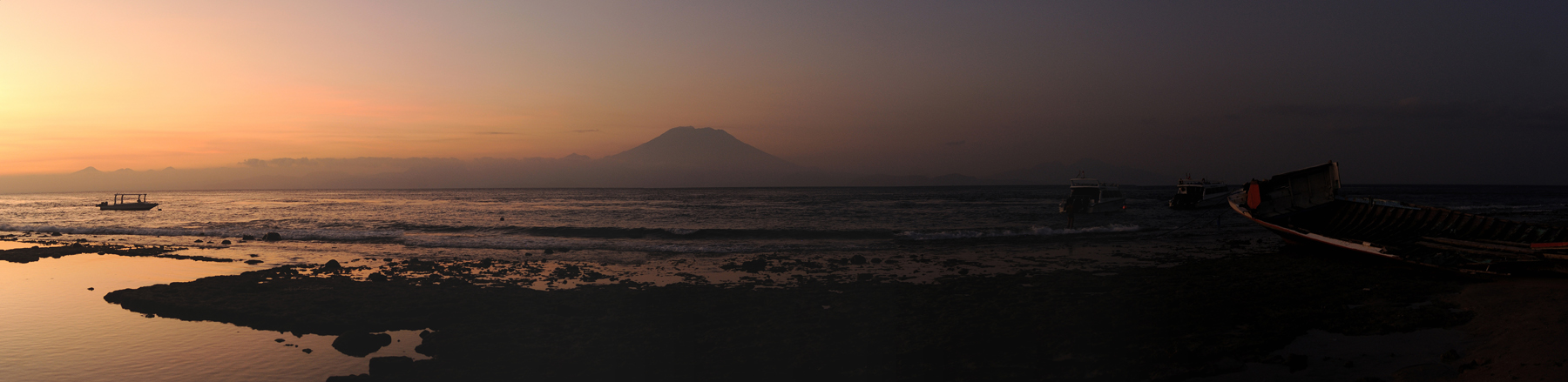 Sunset on Nusa Penida with Mount Agung across the sea
