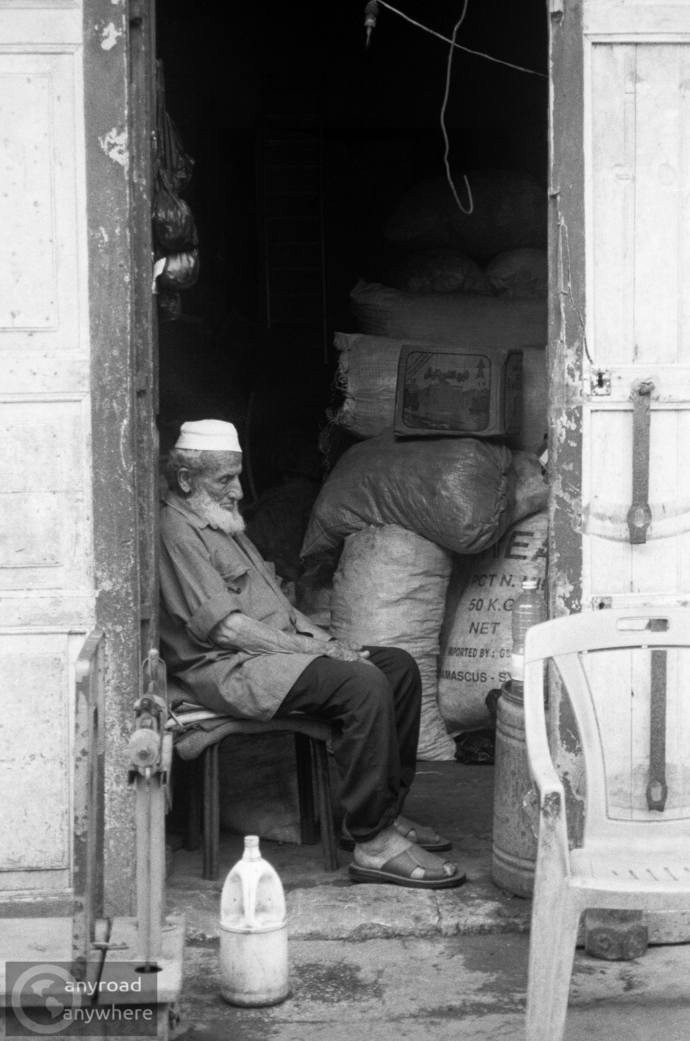 Old man waiting for customers at a market in Aleppo
