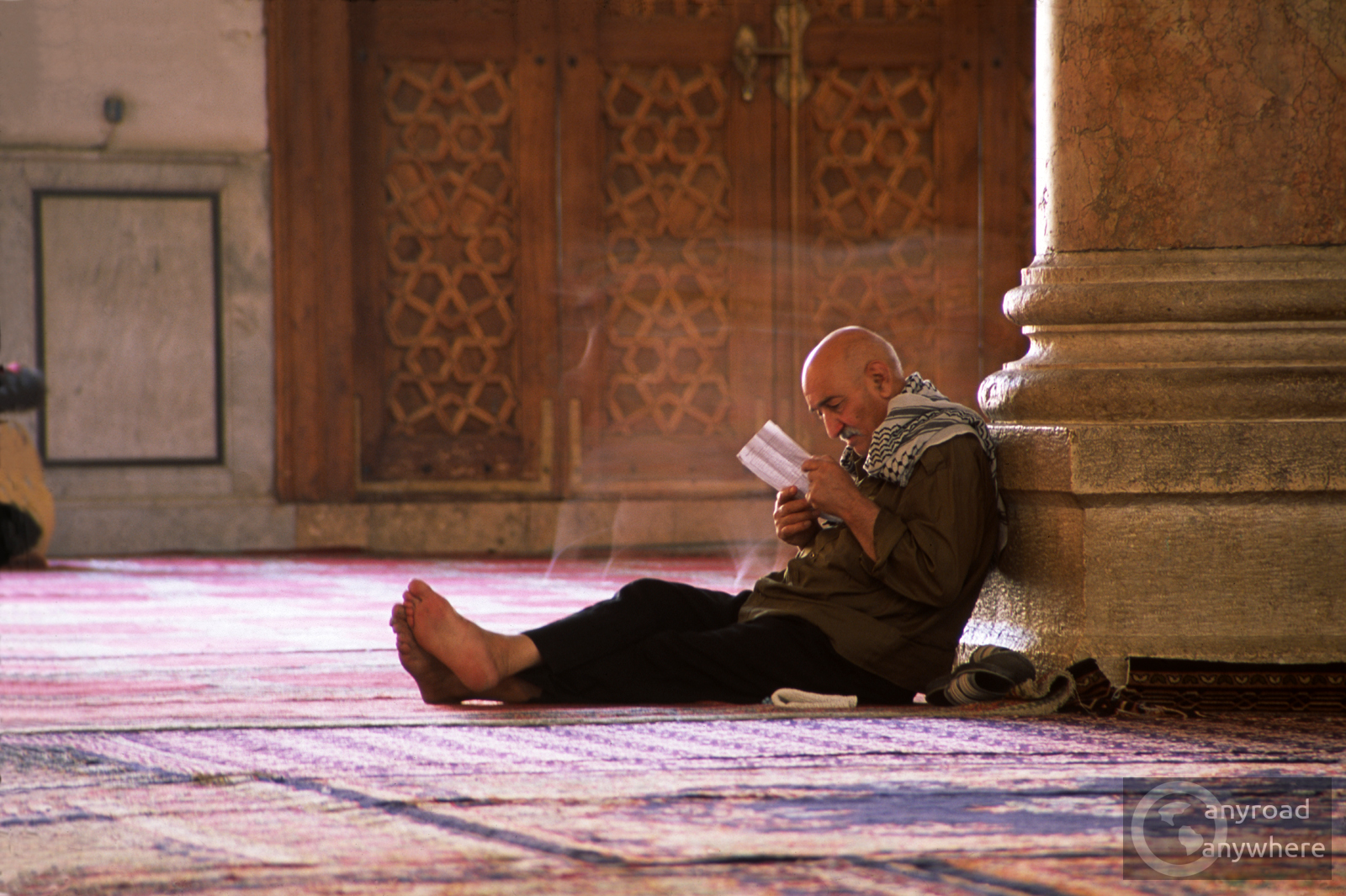 A man lost in his book in the Omayyad Mosque, Damascus