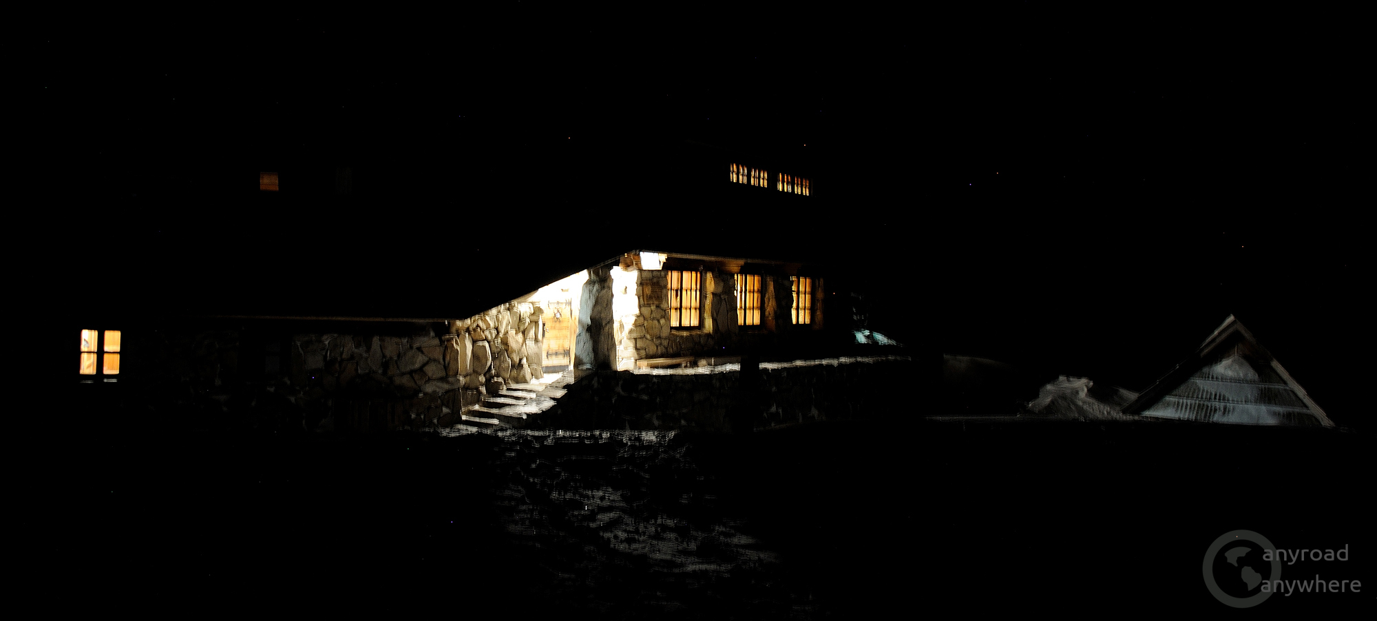 Inviting lights of the mountain shelter on a cold winter day