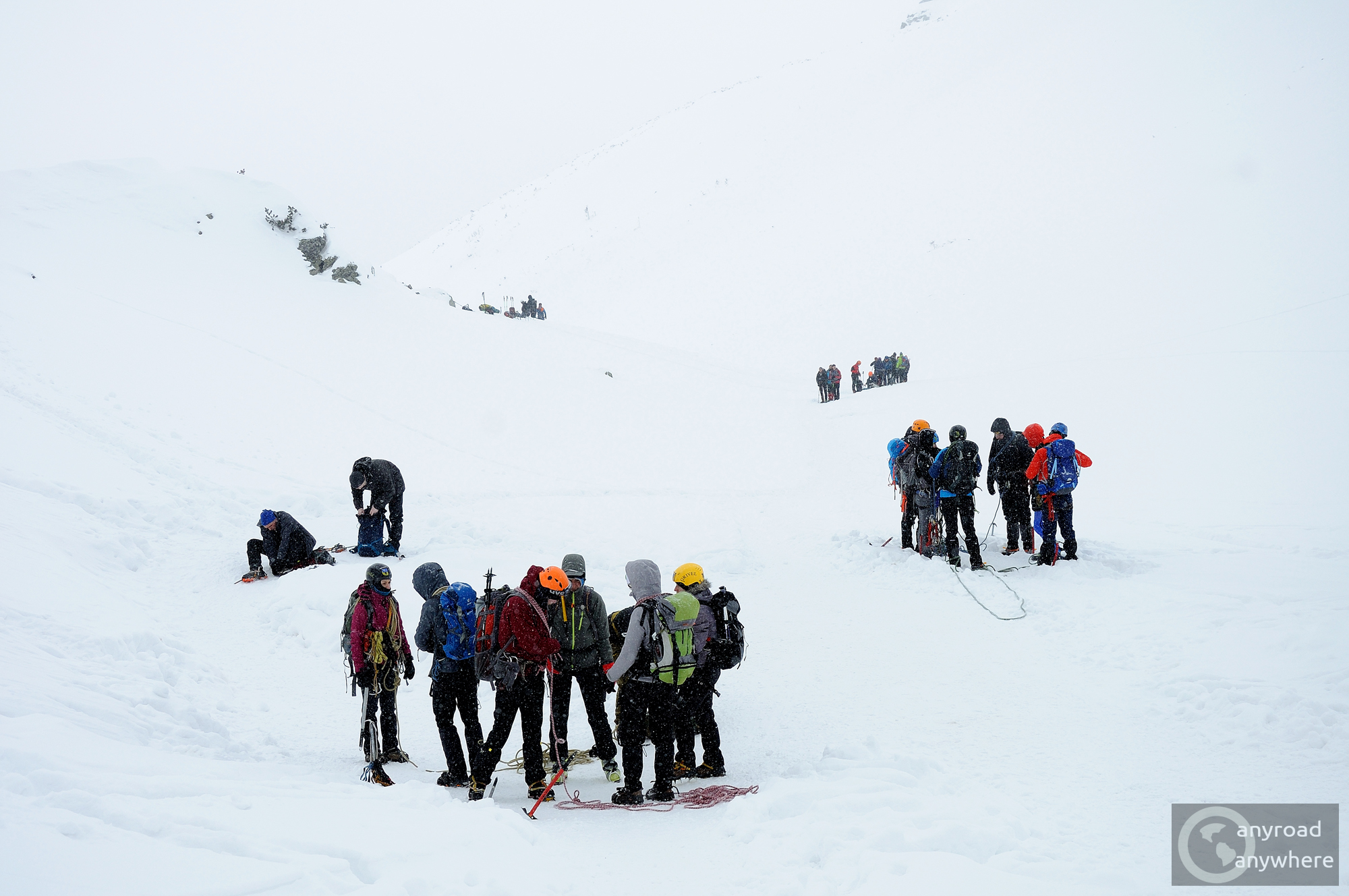 Groups of mountaineers and trekkers prepare for the day under the Zawrat Pass