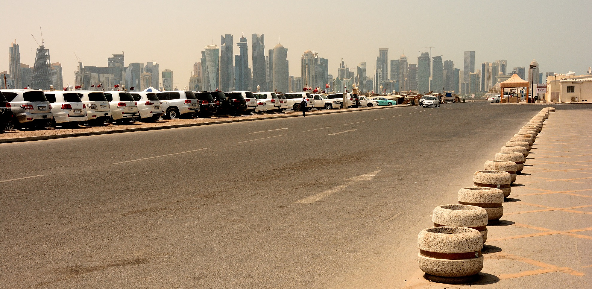 Road on an artificial island with the skycrapers of Doha in the background
