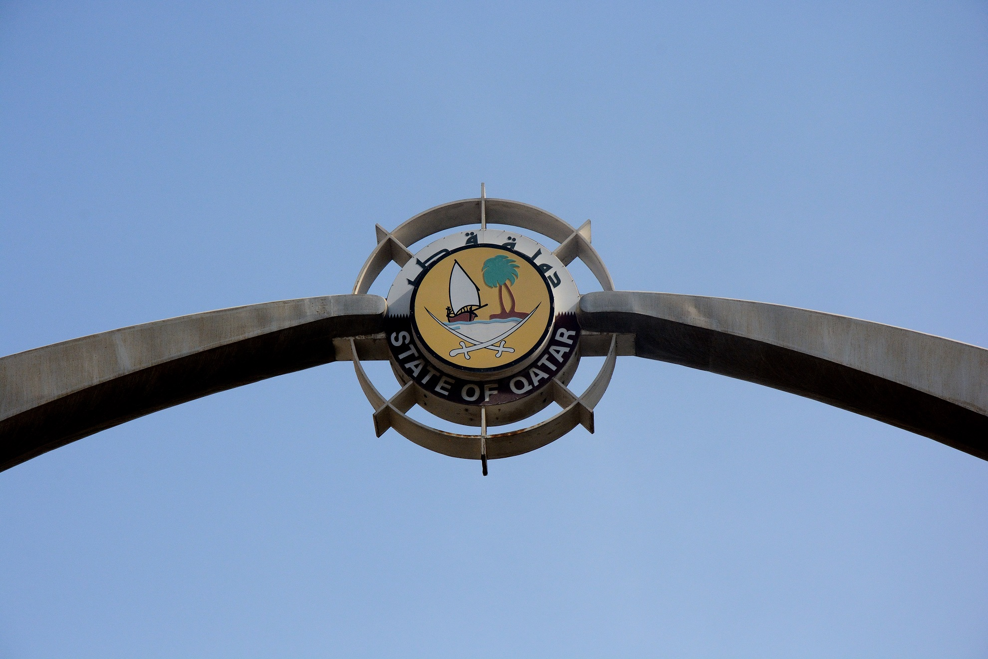 Emblem of the city over one of its main roads