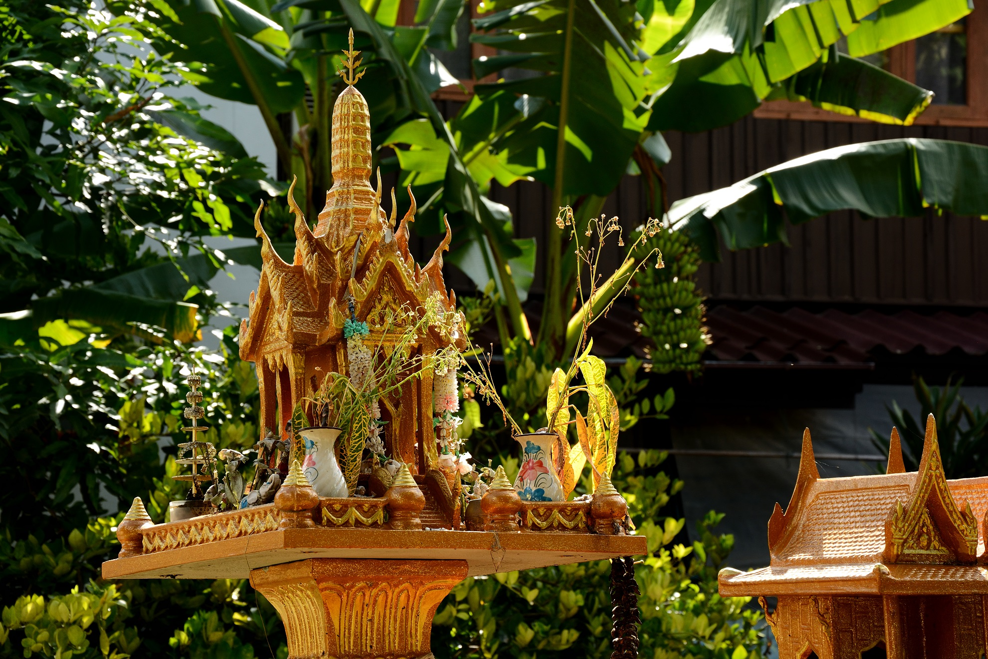 Family shrine in front of a house in Chiang Khong